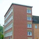 Blick auf den Verwaltungstrakt mit noch unsanierter Fassade © 2017 Betrieb für Bau und Liegenschaften Mecklenburg-Vorpommern