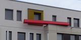 UNSICHERHEITSFAKTOR  - so lautet der Titel des Kunst am Bau-Objektes  einer  Fassadeninstallation des Berliner Künstlers Peter Sandhaus © 2020 SBL Greifswald